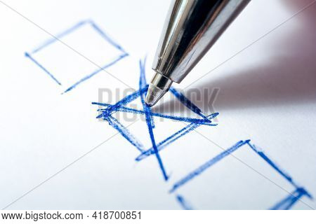 Writing A Check Mark In A Checkbox With A Pen On White Paper - Every Vote Counts Concept