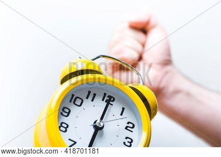 Fist Turning Off Alarm Clock At 6 Oclock In The Morning
