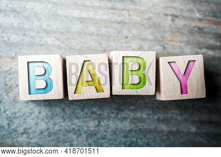Baby Written On Wooden Blocks On A Board