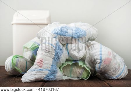 Diapers Waste, Dirty Diapers In Garbage Pail Disposing Of Used Baby Nappies. Environmental Impact Of