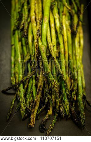 Char-grilled Green Asparagus In Retail Display At Local Market