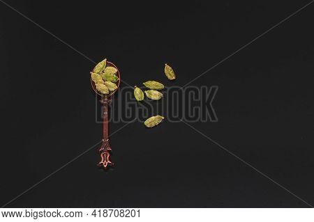 Dry Green Cardamom Seeds(elettaria Cardamomum) On Vintage Cooper Oriental Design Spoon Close Up, Car