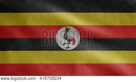 Ugandan Flag Waving In The Wind. Close Up Of Uganda Banner Blowing Soft Silk.