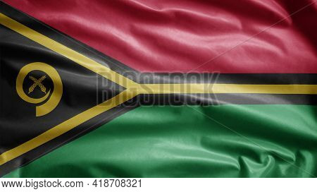 Vanuatuan Flag Waving In The Wind. Close Up Of Vanuatu Banner Blowing Soft Silk.