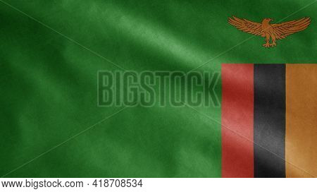 Zambian Flag Waving In The Wind. Close Up Of Zambia Banner Blowing Soft Silk.