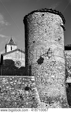 Stone Medieval Tower And Church With A Bell Tower In The Ardeche Region Of France, Monochrome