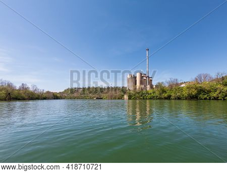 Industrial Power Station On The Banks Of The Monongahela River On A Calm Spring Day In Morgantown, W
