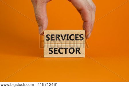 Services Sector Symbol. Wooden Blocks With Words 'services Sector' On Beautiful Orange Background. B