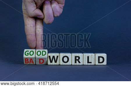 Good Or Bad World Symbol. Businessman Turns Wooden Cubes And Changes Words 'bad World' To 'good Worl