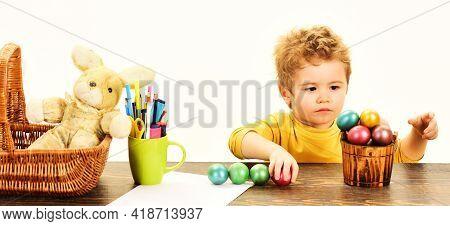 Little Child Painting Easter Eggs. Childrens Easter Creativity. Kid Boy Decorate Easter Egg.