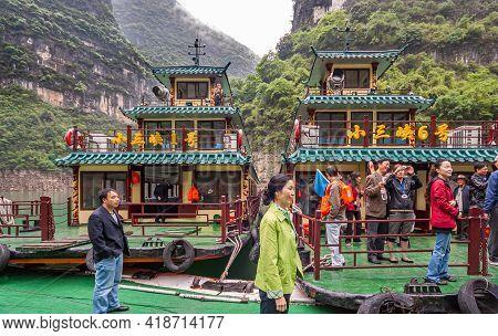 Wushan, Chongqing, China - May 7, 2010: Mini Three Gorges. Luxury Tourtist Sightseeing Boats Docked