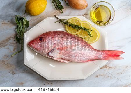 Fresh Whole Raw Head-on Red Snapper With Seasoning Ingredients