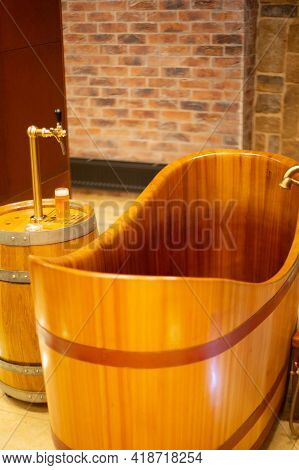 Pilsen, Czech Republic, 1.09.2019 - Empty Wooden Bathtub At Beer Spa. Beer Tasting Mug And Copper Fa