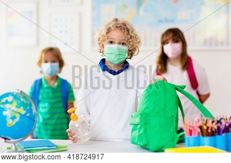 Hand Sanitizer In School. Child In Face Mask.