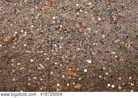 Coins At The Bottom Of The Well. Coins Of Various Denominations Among The Rubble At The Bottom Of A