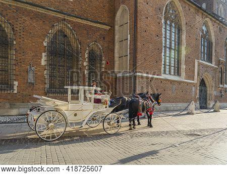 Krakow Poland August 2020. Horse Taxis Outside St Marys Basilica, Krakow, Old Town, Lesser Poland, P