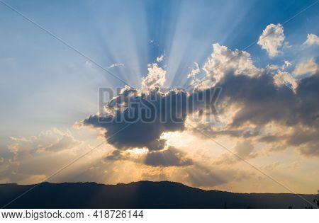 Landscape Picture Mountain And Sun Rays Penetrating Through Clouds