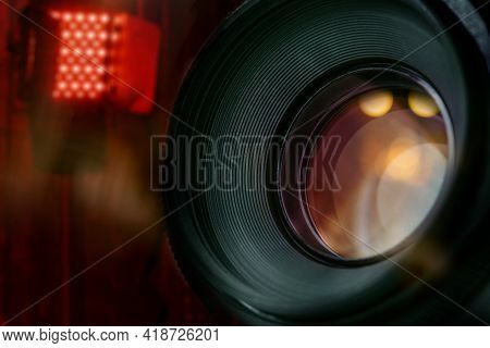 Closeup Of Lens Of Dslr Camera In Studio With Blurred Background