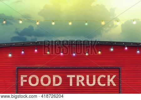 Detail Of Closed Red Food Truck With Light Bulb In Colored Sky Background, No People