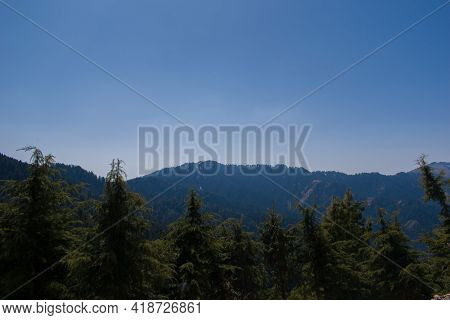 Beautiful Mountain Valley Covered With Himalayan Cedar (deodar) Forest In Himachal Pradesh, India