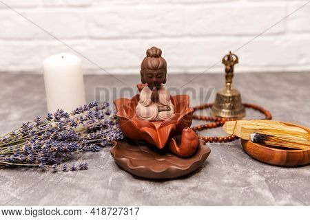 Incense For Praying Buddha Or Hindu Gods To Show Respect. Buddha Statue With Decorations And Incense