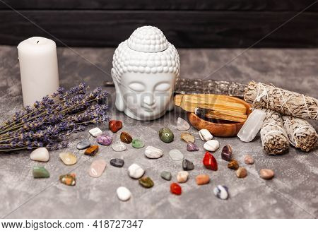 Spiritual Ritual Meditation Face Of Buddha, Candles On Grey Background. Mineral Collection. Set Of C