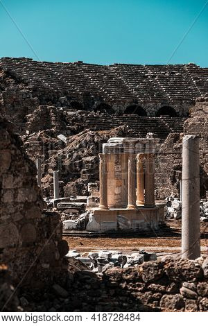 An Antique Ruined City Of Columns,  Amphitheater.ruin. View Of The Ancient City In Side, Turkey.