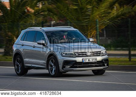 Alanya, Turkey  - April 13  2021:  Silver Volkswagen Tiguan  Is Driving Fast On The Street On A Warm