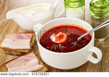 Sauce Boat With Sour Cream, Salt And Pepper Shakers, Borscht With Sour Cream And Dill In White Bowl,
