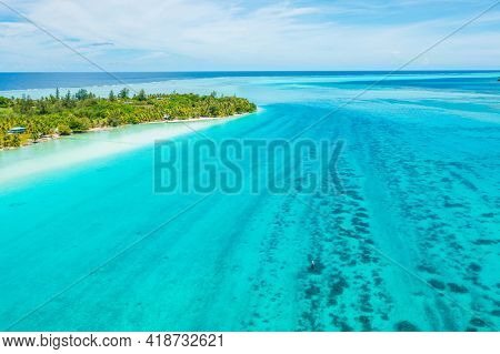 Climate change an Rising sea levels concept photo French Polynesia. Global warming and rising sea levels are a threat to Huahine depicted in image, Tahiti and other island nations. Travel destination