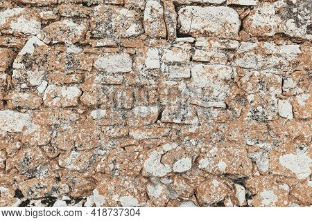 Antique Natural Stonewall. Background Of Stone Wall Texture