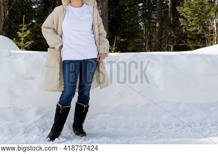 White Sweatshirt Mockup Of A Girl In Quilted Snow Boots, Model Mockup