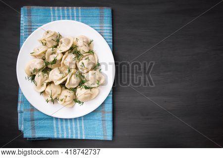 Meat Dumplings - Russian Dumplings, Dumplings With Meat On A Plate On A Black Background