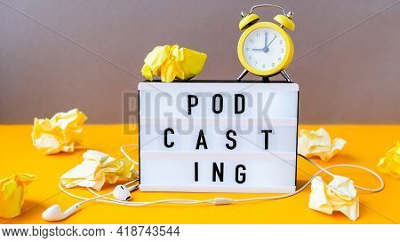 Podcasting Lettering And Alarm Clock, Headphones, Crumpled Yellow Paper In Minimalistic Isometric St