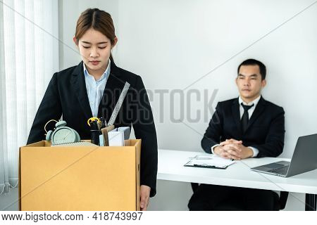 Business Woman Employee In Suit Is Stressed And Carrying Personal Belongings In Brown Cardboard Box