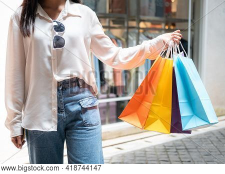 Close Up Of Asian Woman Shopaholic Hand With Many Colorful Shopping Bags After Just End Up Shopping