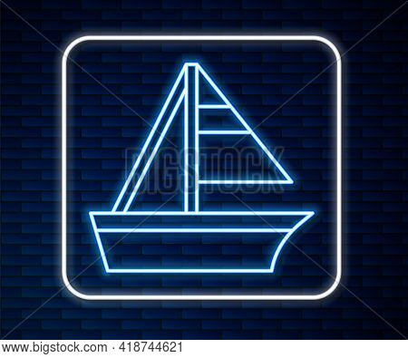 Glowing Neon Line Yacht Sailboat Or Sailing Ship Icon Isolated On Brick Wall Background. Sail Boat M