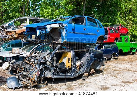 many junk cars in a junkyard waiting for their transport in dei crusher.