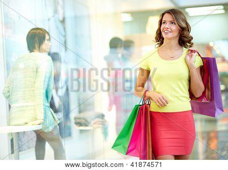 Young woman admiring shop-windows
