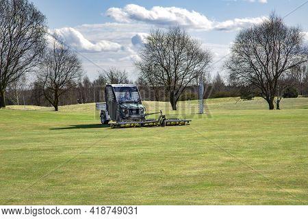 Latvia, Riga, April, 2021 - A Golf Ball Collecting Vehicle At The Golf Course In Riga, Latvia