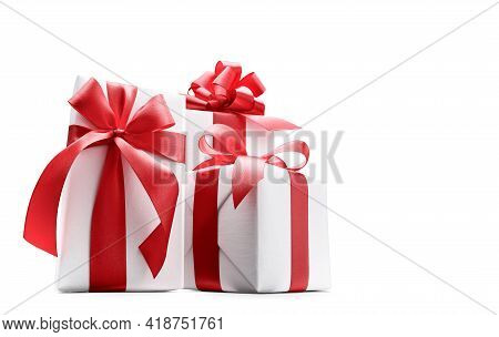 Low-angle Shot Of White Color Gift Boxes With Red Bows Isolated On White Background - Clipping Path