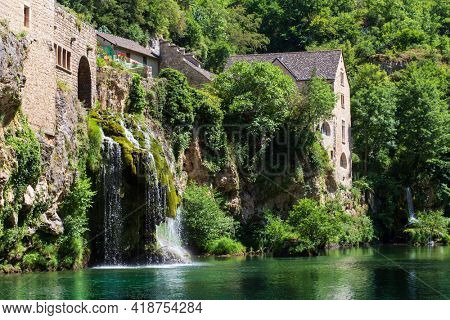 Saint-Chély-du-Tarn village and cascade, Sainte-Énimie, Lozère, France