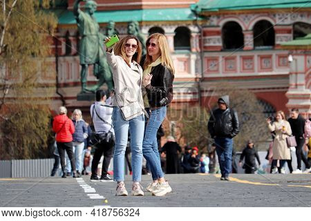 Moscow, Russia - April 2021: Two Happy Girls Taking A Selfie With Smartphone Standing On The Red Squ