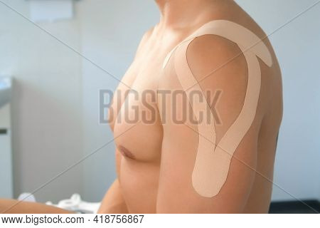Kinesiology Tapes On Mans Shoulder And Hand For Fixation Of Muscles, Closeup. Using Of Tapes In Medi