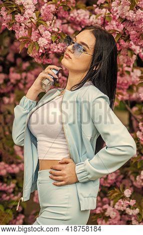 Give Pleasant Scent. Eau De Toilette. Luxury Fragrance. Fashionable Woman Hold Perfume Bottle. Cherr
