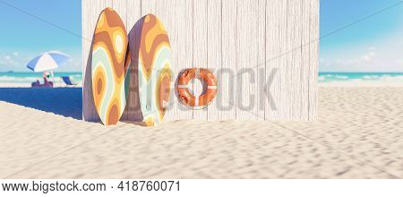 Wooden Hut On The Beach With Surfboards Leaning On It And Lifebuoy Hanging With The Sea In The Backg