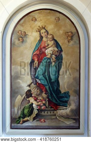 LUN, CROATIA - AUGUST 17, 2013: Virgin Mary with baby Jesus altarpiece at St. Jerome parish church in Lun, Croatia