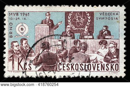 ZAGREB, CROATIA - SEPTEMBER 18, 2014: Stamp printed in Czechoslovakia shows Scientists Meeting and Nuclear Physics Emblem, International Trade Fair, Brno, circa 1961