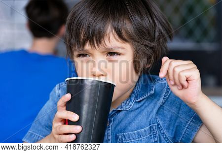 Close Up Face Cute Toddler Boy Drinking Cold Drink, Happy Child Sitting In Cafe Drinking Soda Or Sof