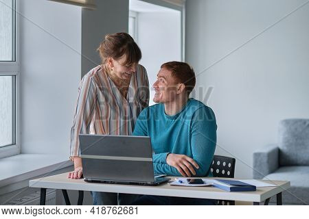Son Shows His Mother Or Grandmother How To Create A Personal Page On The Social Network. Seniors And